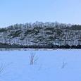 日の落ちた湿原を横切る「SL冬の湿原号」